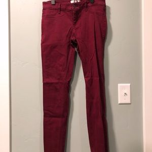 Maroon-colored skinny jeans
